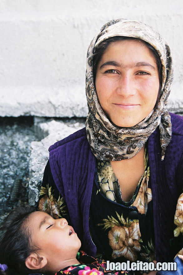 Photo of Afghan refugee with baby in Almaty, Kazakhstan - Central Asia