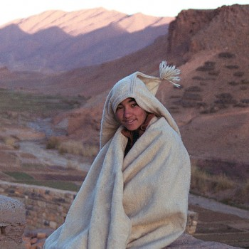 Young boy wearing a traditional anzar in the Atlas Mountains, Morocco - North Africa