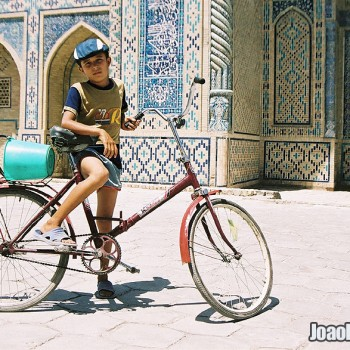 Boy with bicycle in Bukhara, Uzbekistan - Central Asia