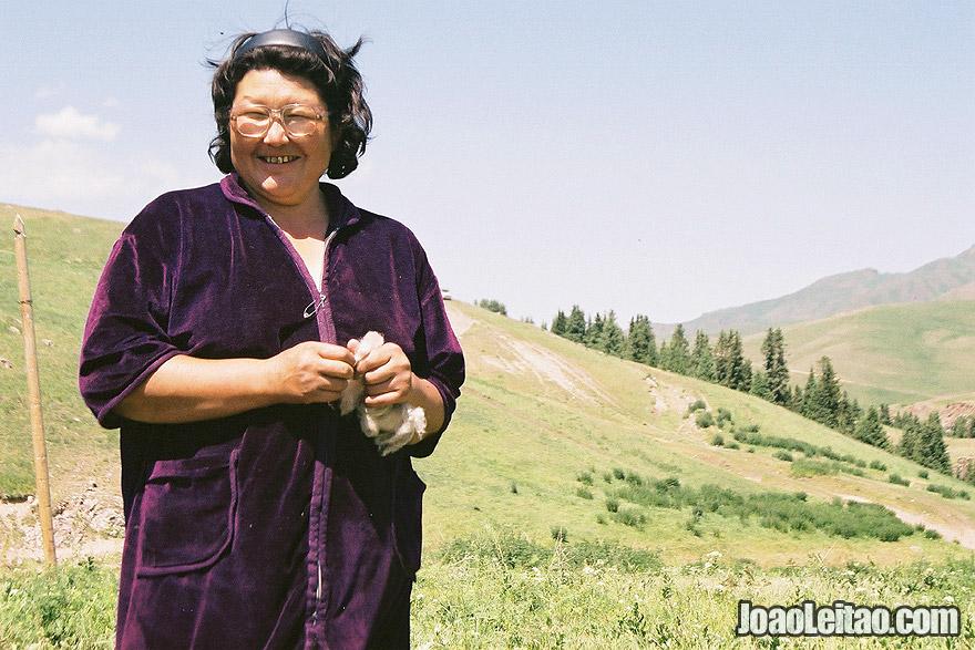 Photo of Kazakh nomad woman in Ile-Alatau National Park, Kazakhstan Central Asia