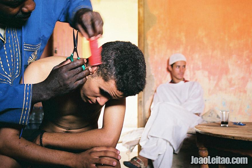 Hairdresser in Erg Chebbi Dunes, Sahara Desert, Morocco - North Africa