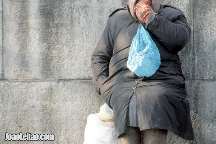 Woman with blue plastic bag in Moscow, Russian Federation - Eastern Europe