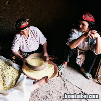 Berber women preparing couscous in Tamtettoucht, Atlas Mountains, Morocco- North Africa