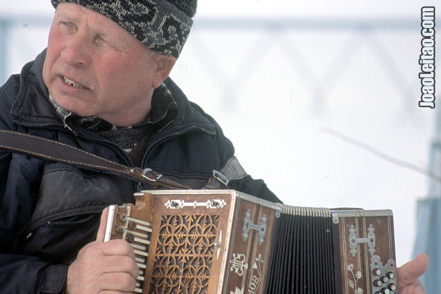 Musician playing Harmonica near Suzdal, Russian Federation - Eastern Europe