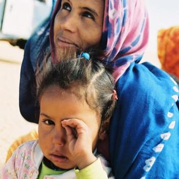 Woman and child on Sahara Desert Tracks Sebkhet Oum way to Bir Moghrein, Northern Mauritania